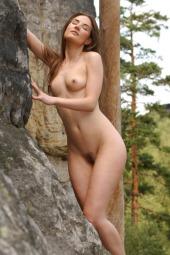 Nude girl swimming in the lake