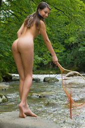 Naturist girlfriends having fun in water