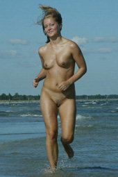Nudist blonde running in the water