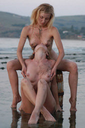 Teen nudist on the big stone in the water