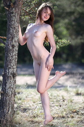 Sweet naturist girl in the forest