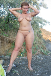 Busty naturist in the forest