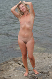 Hairy pussy naturist in the water