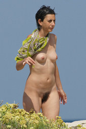 Hairy pussy nudist girl walking at the beach