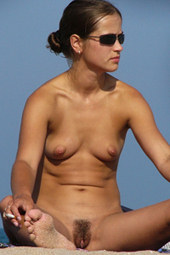 Hairy pussy chick in black glasses at nude beach