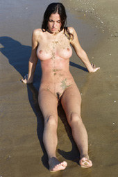 Busty girl at sandy beach
