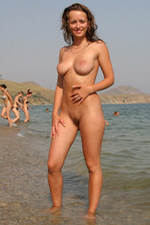 Sexy busty black sea nudist girl