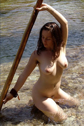 Hairy naturist in the river