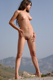 Hairy pussy young girl getting tan on the rocks