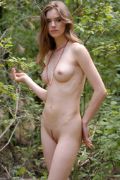 Exciting nude goddess in the forest