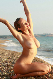 Busty chick nude on the beach