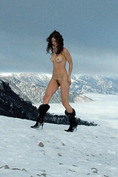 Girl with hairy pussy playing public nude in the snow on the top of the hill