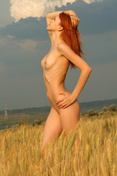 Exciting redhead naturist in the field by the river