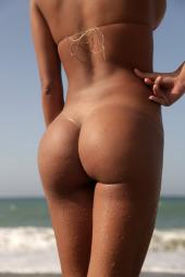 Tasty beach girl in invisible bikini