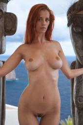 Nude busty redhead girl sea view