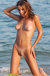 Hot busty girl in red bikini going nude at the seaside