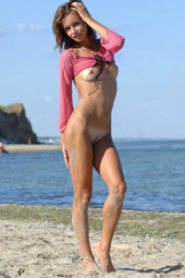 Amazing girl in pink outfit is nude on the beach