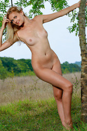 Blonde is nude in the field