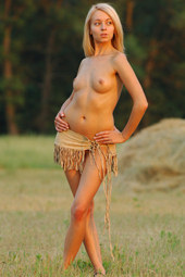 Blonde naturist nude outside