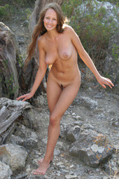 Busty beautiful naturist in the forest