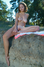 Busty beauty nude outdoor