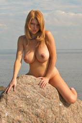 Busty nature hottie at the beach side