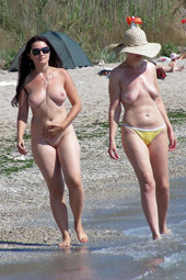 Busty nude beach trio