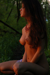 Exciting brunette is nude in forest during sundown