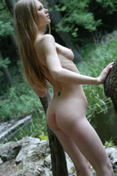 Exciting nude blonde girl by the forest lake and ruins