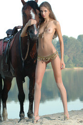 Girl nude at the lake with the horse