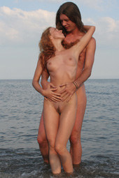 Hairy pussy naturist and boy in the water