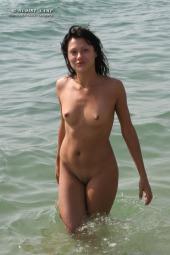 Puffy nipples nudist brunette in the sea