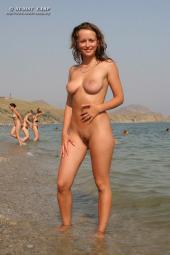 Sexy busty black sea nudist girl