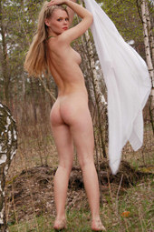 Teasing blonde is nude in the forest