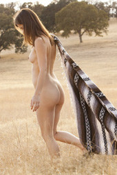 Teen naturist baby in the field
