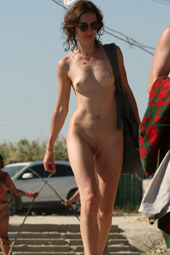Walking nude at the beach