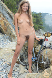 Young hairy pussy naturist cycling after fishing